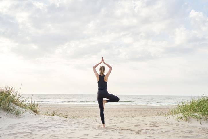 women practicing yoga at summer yoga retreat
