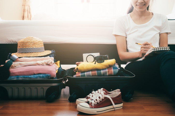 young woman with a checklist for her wellness vacation