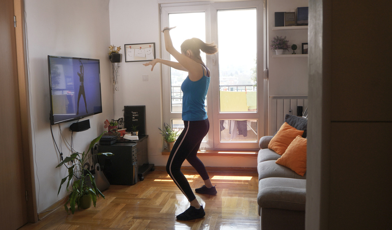 woman doing a dance workout at home