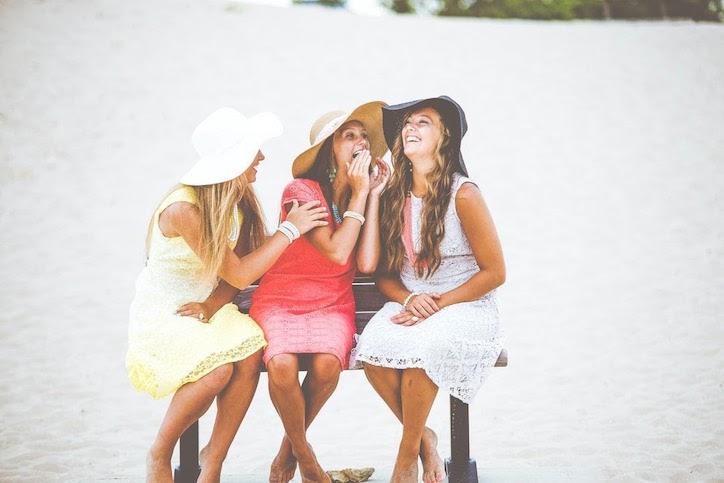 women-lauging-on-beach